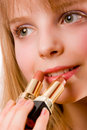 Beautiful teenager girl with two lipsticks in hand Stock Photo