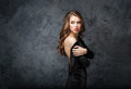 Beautiful tender young woman in black dress with open back Royalty Free Stock Photo