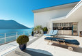 Beautiful terrace of a penthouse overlooking the lake outside Stock Images