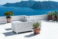 Beautiful terrace in Santorini with view on the volcano Royalty Free Stock Photo