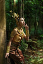 Beautiful thai lady in thai traditional drama dress posing the forest greenery the background model is ethnicity Stock Images