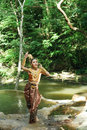 Beautiful thai lady in thai traditional drama dress posing the forest greenery the background model is ethnicity Stock Image
