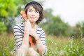 Beautiful thai woman with Ukulele in garden Stock Photo