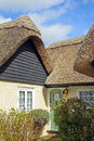 Beautiful thatched kent cottage photo showing a pretty roof located in rural countryside Royalty Free Stock Image