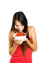 Beautiful thin brunette with strawberries. Royalty Free Stock Images