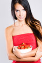 Beautiful thin brunette with strawberries. Royalty Free Stock Photo