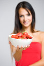 Beautiful thin brunette with strawberries. Royalty Free Stock Photos