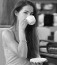Beautiful thinking girl drinking Royalty Free Stock Photo