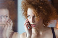 Beautiful thoughtful curly young redhead woman talking on cell phone Royalty Free Stock Photo