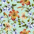 Beautiful tiger lilies and small blue flowers on twigs against light blue background. Seamless floral pattern. Watercolor painting