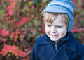Beautiful toddler boy in blue coat on winter day Royalty Free Stock Photo