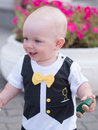 Beautiful toddler walking with his mother on a city holiday. Kid stylishly dressed butterfly and cap Royalty Free Stock Photo