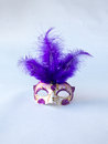 Beautiful Traditional Venetian Style Purple and White with Long Feather Carnival Mask, Gorgeous Masquerade Accessories on White Royalty Free Stock Photo