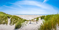 Beautiful tranquil dune landscape and long beach at North Sea, Germany Royalty Free Stock Photo