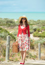 Beautiful traveler lady in red near the sea in retro style Stock Images