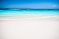Beautiful tropical beach, white sand and blue sky background. Royalty Free Stock Photo