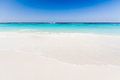 Beautiful tropical beach, white sand and blue sky background wit Royalty Free Stock Photo
