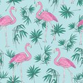 Beautiful tropical seamless pattern with pink flamingo birds and green jungle palm foliage hand drawn on blue background Royalty Free Stock Photo