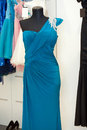 Beautiful turquoise gown on mannequin in a bridal shop Royalty Free Stock Photo