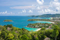 Beautiful turquoise ocean waves with boats and coastline from high view point. Kata and Karon beaches Royalty Free Stock Photo