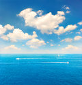 Beautiful turquoise sea water and perfect blue sky with white clouds Royalty Free Stock Images