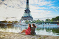 Beautiful twin sisters near the Eiffel tower in Paris, France Royalty Free Stock Photo