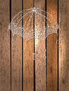 Beautiful umbrella over wood with drops background Royalty Free Stock Photos