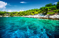 Beautiful uninhabited island transparent blue water romantic lagoon in greece moored luxury sail boat in the bay of mediterranean Stock Photo
