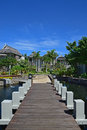 Beautiful upscale resort hotel with small wooden bridge connecting the walkway with the villas suitable settings for honeymoon Stock Photography