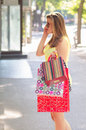 Beautiful urban girl shopping on sunny summer day Royalty Free Stock Images