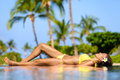 Beautiful vacation woman relaxing at a spa resort Royalty Free Stock Image