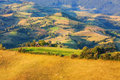 Beautiful valley in transylvania with pastures and fields at sunset Stock Photos