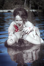 Beautiful vampire woman dressed white bloody shirt and her victi Royalty Free Stock Photo