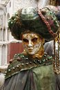 Beautiful venetian mask at St. Mark square during the carnival of Venice. Italy