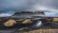 Beautiful Vesturhorn Mountain and black sand dunes in Iceland. Royalty Free Stock Photo