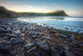 Beautiful vibrant sunrise over rocky beach Royalty Free Stock Photography