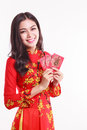 Beautiful vietnamese woman with red ao dai holding red packet li xi on white background Royalty Free Stock Photos
