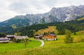 A beautiful view of the austrian alps with typical mountain hous houses austria Stock Image