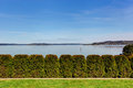 Beautiful view of bay and trimmed hedges on sunny day in seattle Stock Photo
