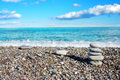 Beautiful view on the beach and column of sea stones Royalty Free Stock Image