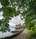 Beautiful view of Chateau de Chillon at Lake Geneva, one of Switzerland`s most visited castles in Europe, with sky full of cloud