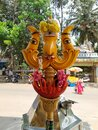 Beautiful view of Goddess Face in the Yellow Color Trishula or Trident in front of the Sri Gangamma Devi Temple Near Kadu