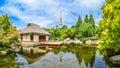 Beautiful view of japanese garden in planten um blomen park with famous heinrich hertz turm radio telecommunication tower the Stock Image