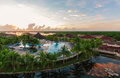 Beautiful view of Memories Caribe resort grounds, buildings and tropical garden on early morning sunrise time