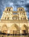 Beautiful view of notre dame cathedral in paris on a clody sprin april facade de april france Stock Image