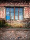 Beautiful view of an old building with red bricks and blue windows Royalty Free Stock Photo