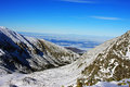 Beautiful view over the mountains from the top of retezat peak romania this image present a in during winter time Stock Photos