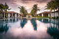 Beautiful view of resort in vietnam asia houses and pool middle reflection purple sky with clouds water tourist modern Stock Image