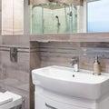 Beautiful villa bathroom in beige