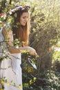Beautiful vintage gardener with elegant water sprinkler spring light Royalty Free Stock Photos